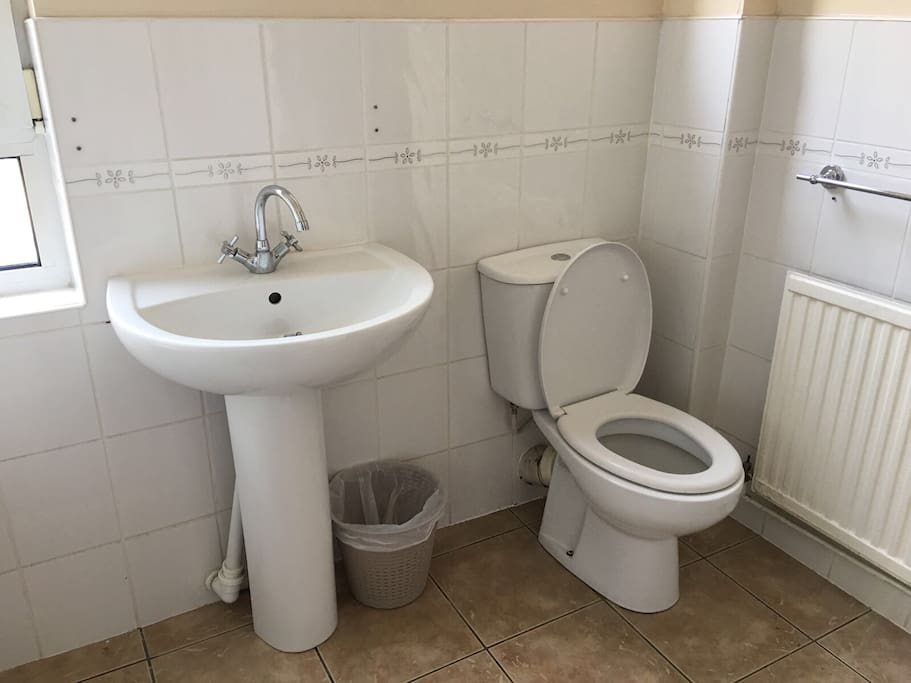 Toilet with bath to the left/ shower