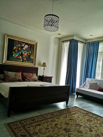 Room 1, double bed and sofa