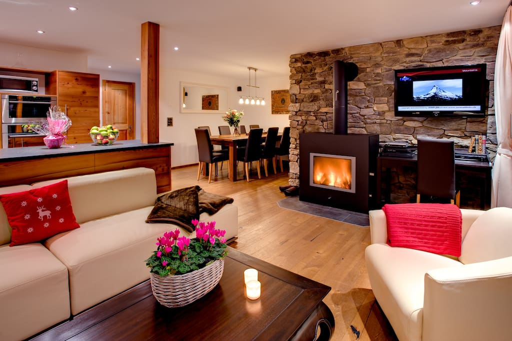 Living room with fireplace and terrace.