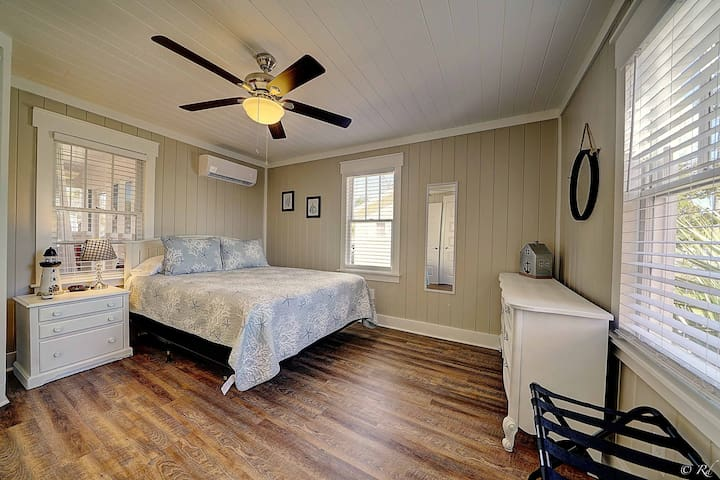 Master bed with dresser and closet