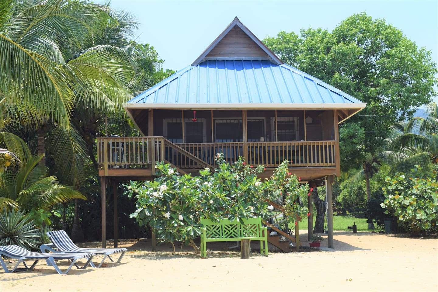 Spooky Channel Guest House from the Caribbean Seashore in Sandy Bay