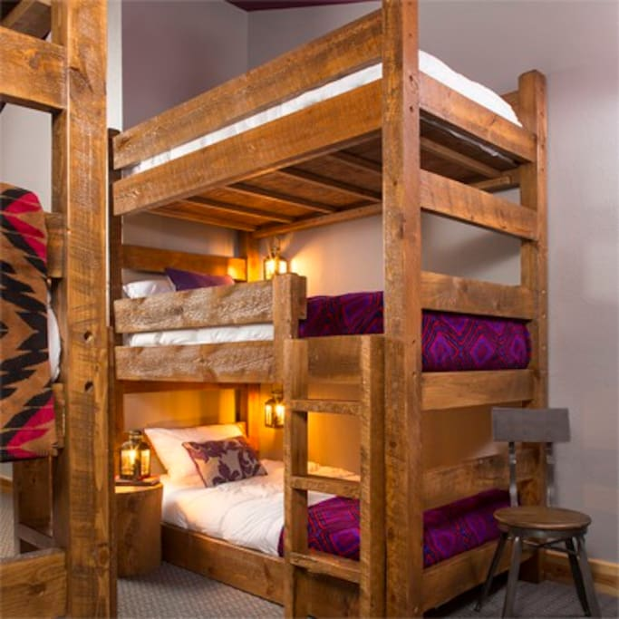 Norwegian Pine Bunks with power outlets and reading lanterns.