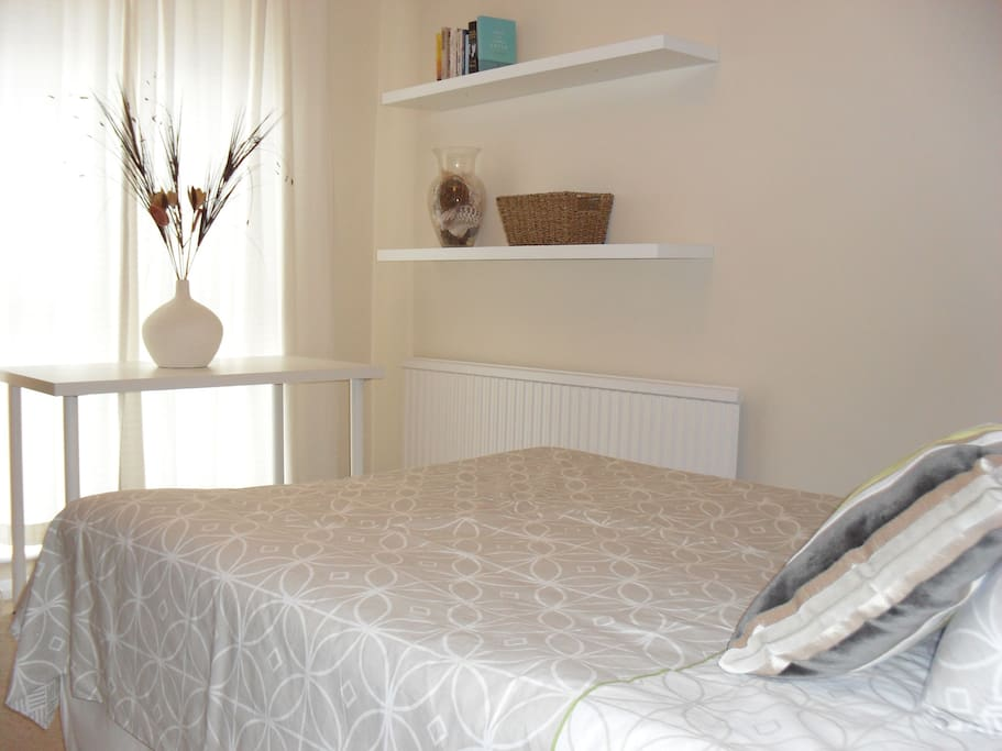 Double Room with garden view. Triple wardrobe, drawers, desk, shelving & TV