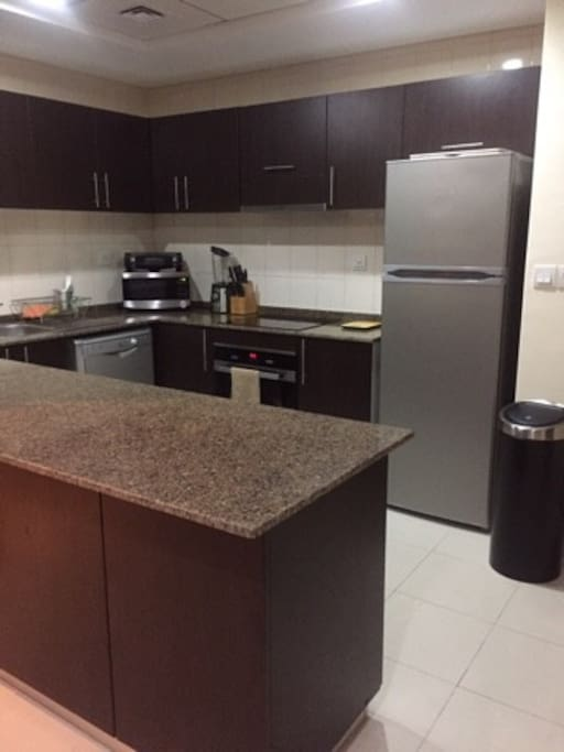 Kitchen Area with fridge, freezer, washing machine, dishwasher