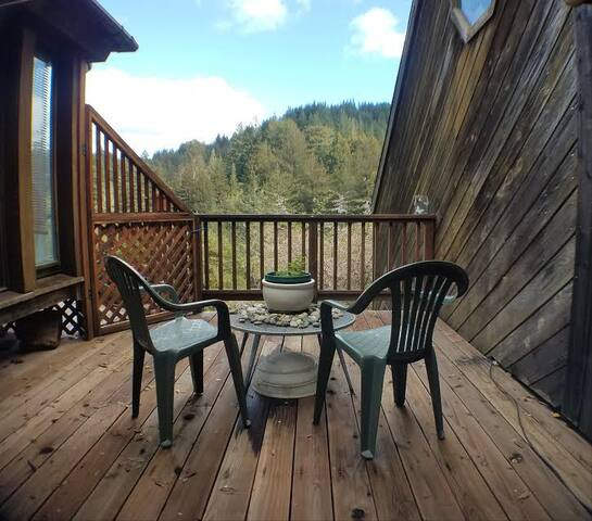 Wake up to this. Your private deck overlooking mountains, redwoods, and garden.