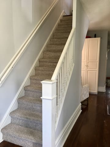 Your room is on the second floor of our home, up these stairs.