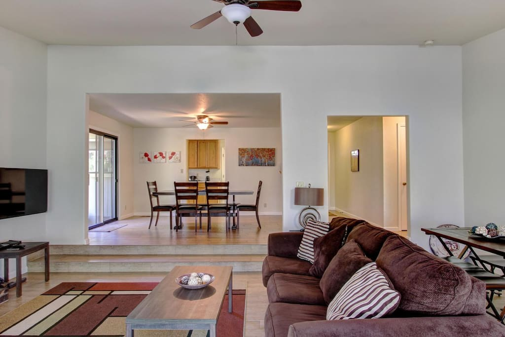 Dining room is connected to the step down living room which also has a table and chairs for 4-6.  Great for entertaining or large families to enjoy a meal and fun times together.  The slider opens out to another small patio with a new 5 burner, propane BBQ.