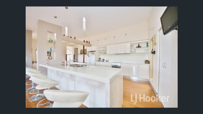 Open plan kitchen  There is also a BBQ area off main living space overlooking Mt Panorama
