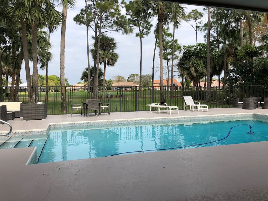 Huge inground pool and deck overlooking the Squire Golf Course.
