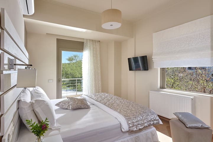 Bedroom with views of the city and the mediterranean sea | autonomus satellite over 700 world wide channels| high quality mattresses, pillows & sheets |safety box | aircondition | closet | cleanliness is our priority.