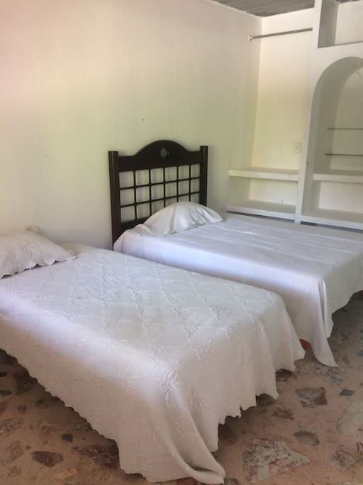 Beds in room with two beds and private bathroom