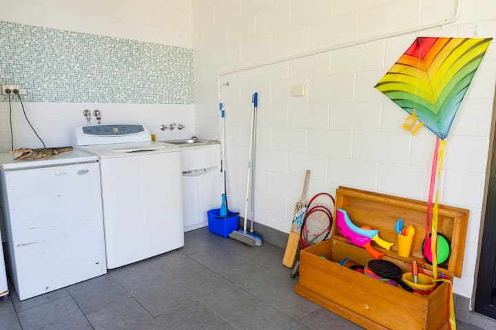 Our laundry is on the back veranda,  we know what it is like holidaying with kids so there is always plenty of washing powder and a supply of pegs.     Oh yes, don't worry about packing beach toys, as you can see we have everything covered!