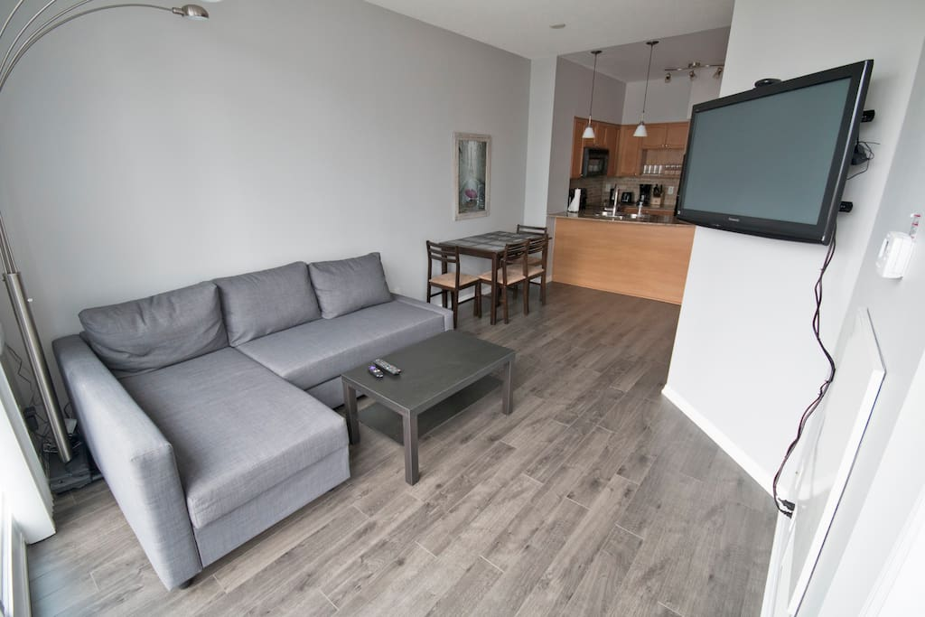 Living room with pull-out couch & kitchen