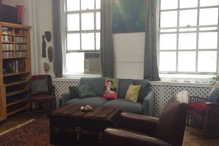 New listing- A beautiful bohemian apartment in the heart of West Village/Meatpacking district.  Available for guests who would like to stay for 1 week or more.  2 queen size beds + 2 sofa beds.  Laundromat in the building.  Perfect for a family of 4.