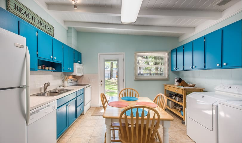 Bright airy kitchen with washer and dryer