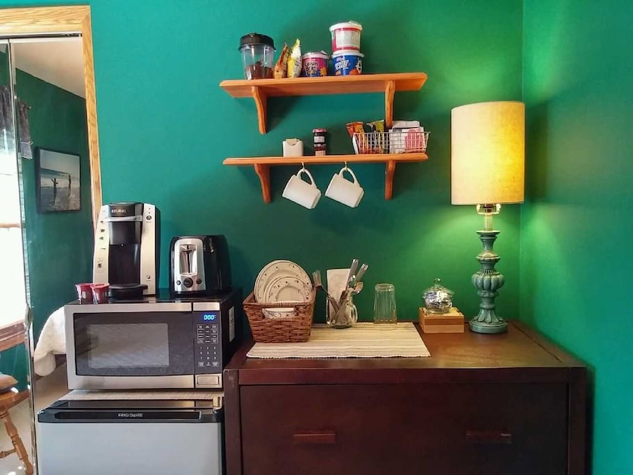 Your room has a microwave, mini-fridge (under the microwave), small coffee maker/water heater, and toaster.  On the shelves, you'll find bread and bagels, individual jellies, peanut butter, and honey, and several types of breakfast cereal.