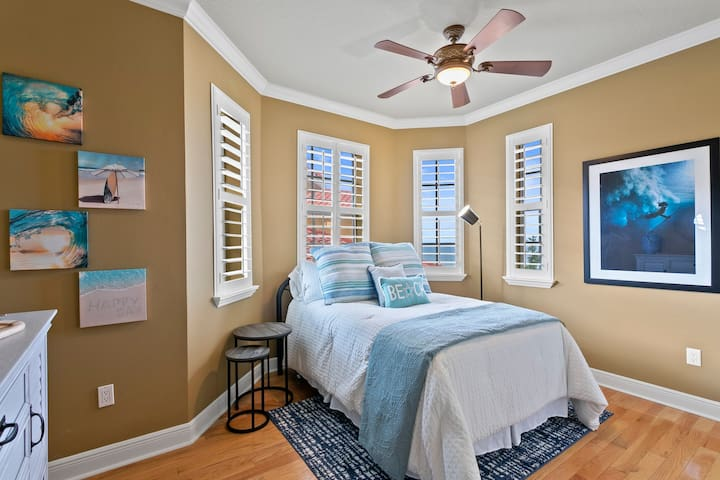 Upstairs guest bedroom #3 with full bed and ocean view bay windows