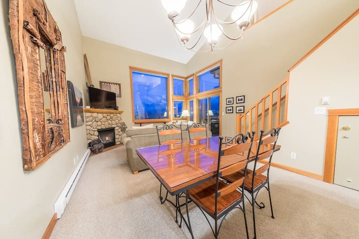 """Our condo is open concept and you can see the mountains throughout our home. We have seating for 6 at the dining table and another couple of stools at the breakfast bar.  """"Their house is even nicer than it looks on the pictures."""" - Mustafa"""