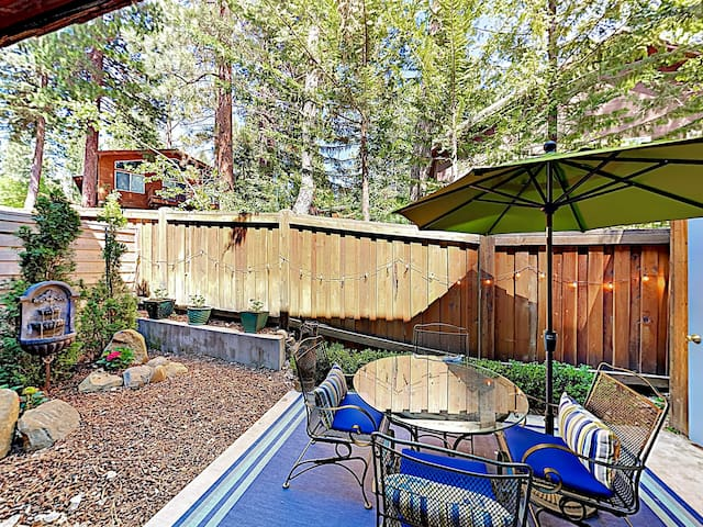 Enjoy a beverage on the peaceful back patio, equipped with a seasonal water feature and garden.