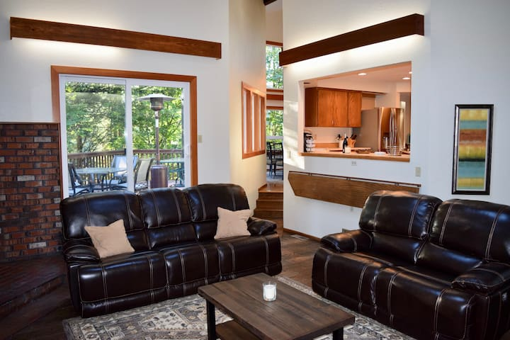 """Family Room with wood pellet stove, 65"""" TV."""