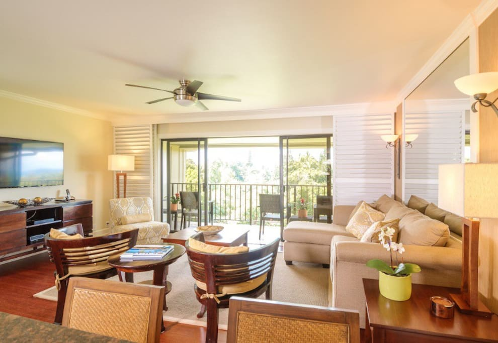 """Spacious Living room , looking out over patio to grounds ( """"garden view""""). We use our timeshare week/condo, so you could be on the 1st, 2nd or 3rd floor."""