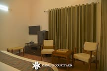 Spacious rooms with extra sitting space, cabinets, T.V., board games, balcony, makes stay more comfortable. Feel free to ask for all the additional amenities that we offer.