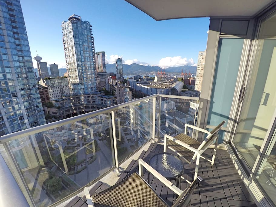 Enjoy a cold drink on the balcony while looking across Downtown all the way to North Vancouver