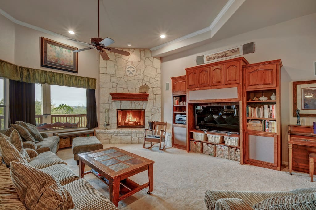 The perfect gathering spot, the living rom has plenty of seating a huge entertainment center