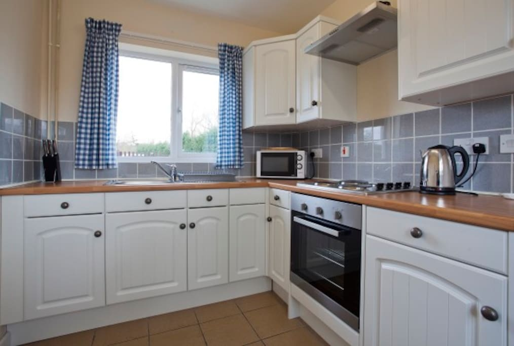 Fully equipped kitchen with large fridge/freezer.