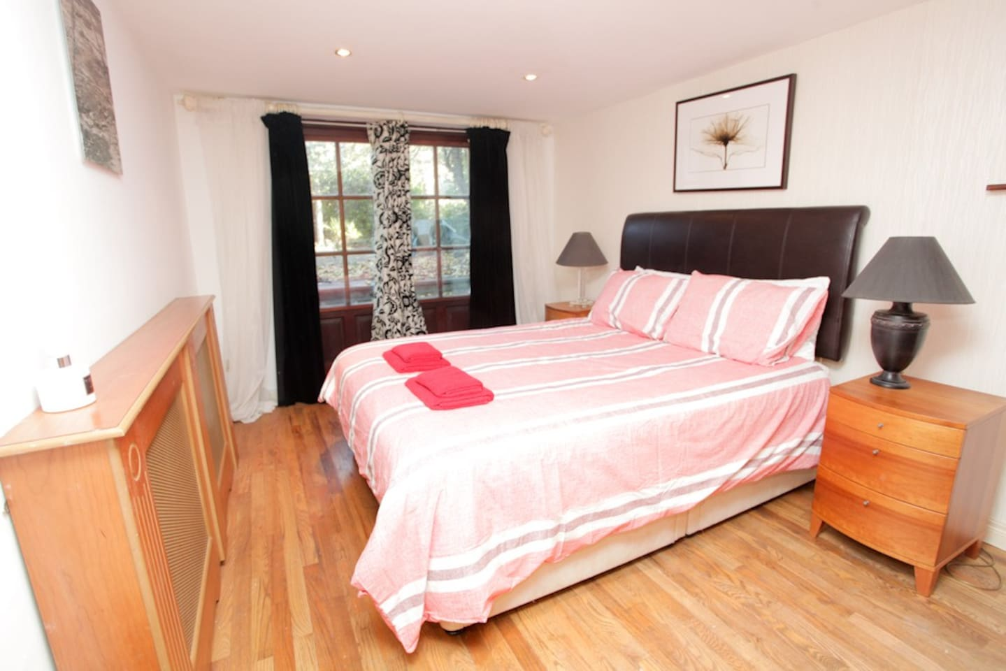 Large double room with doors opening onto sun terrace.