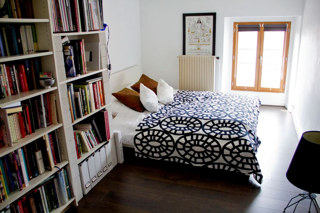 Comfortable king size bed and lots of wine literature