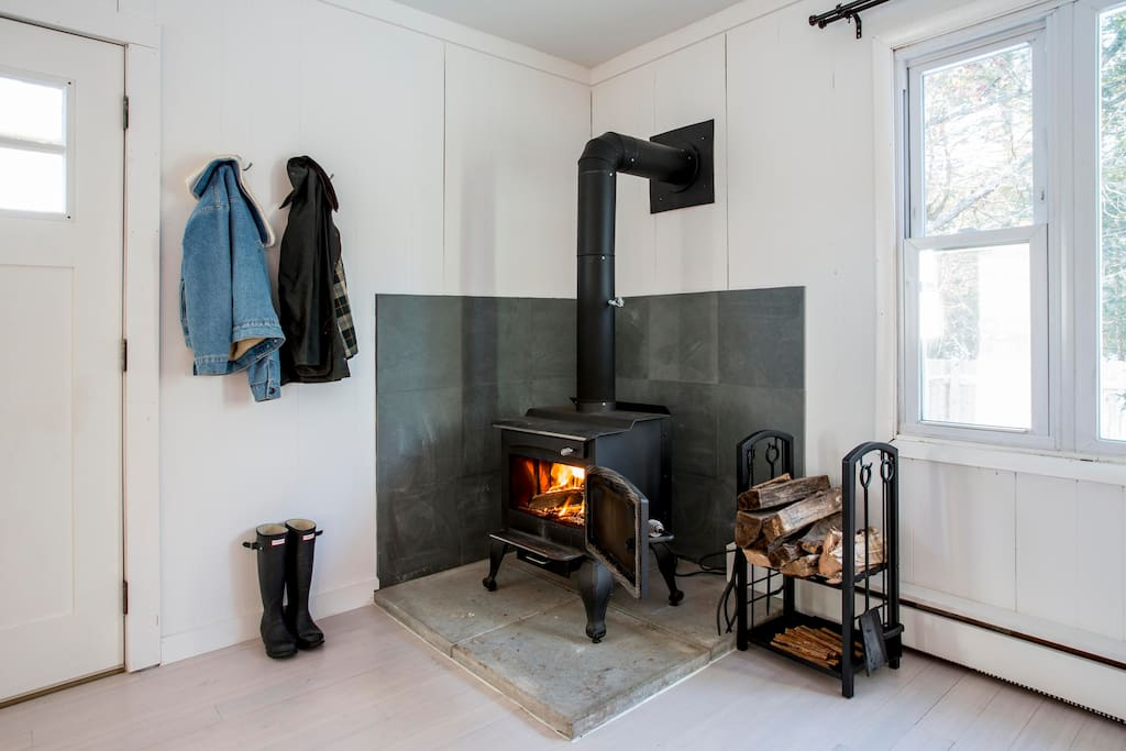 Enjoy the old warm charm of a wood burning stove in a freshly renovated cabin.