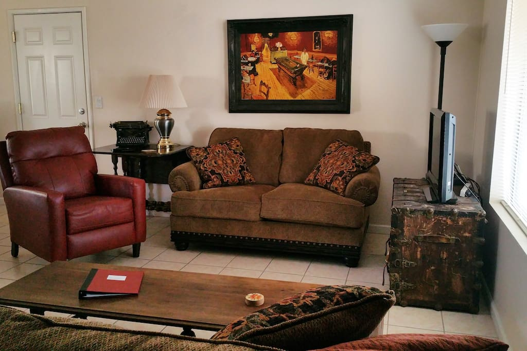 Relax and enjoy the Living Room with Flat Screen TV.