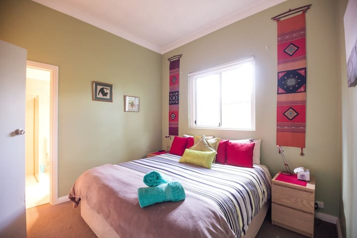 main bedroom with  king bed, en-suite (with bath, shower, toilet and bidet) and walk in wardrobe