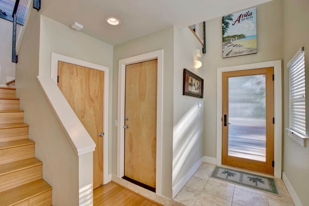 Entry to Avila Beach Escape. Access to attached single car garage and laundry center.