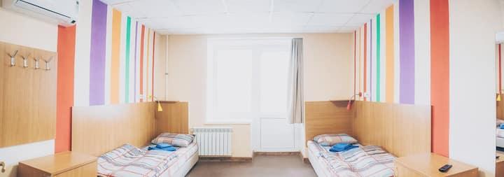 "Номер категории комфорт в хостеле ""еНОТ"""