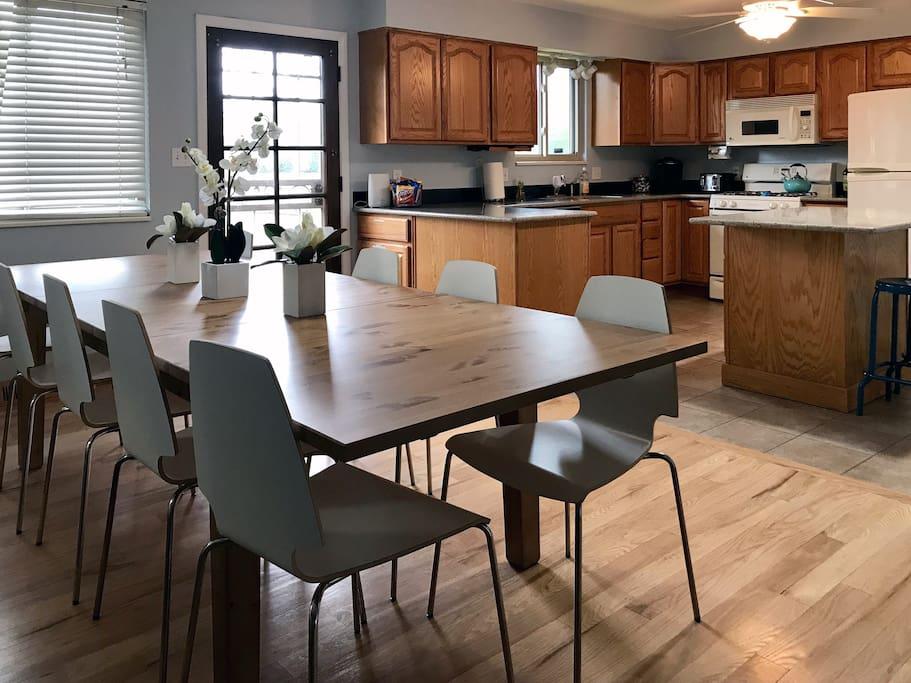 Seating for 10-12 in this well-stocked kitchen with gas stove, Keurig coffee machine, and dishwasher.