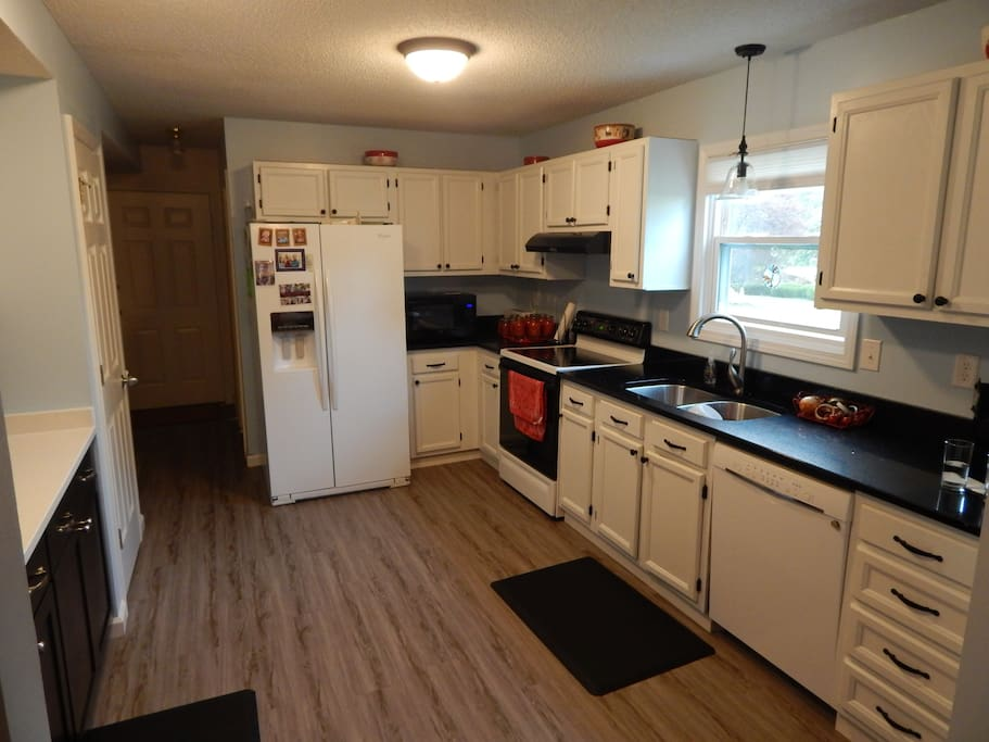 Newly remodeled kitchen with newer appliances and fully stocked kitchen utensils.