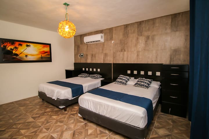Recamara 2 con dos camas matrimoniales, de igual manera de requerirse según el numero de huéspedes podemos integrar un colchón inflable queen size.