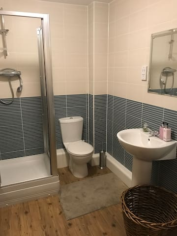 Extra large bathroom  With shower , toilet and hand basin.