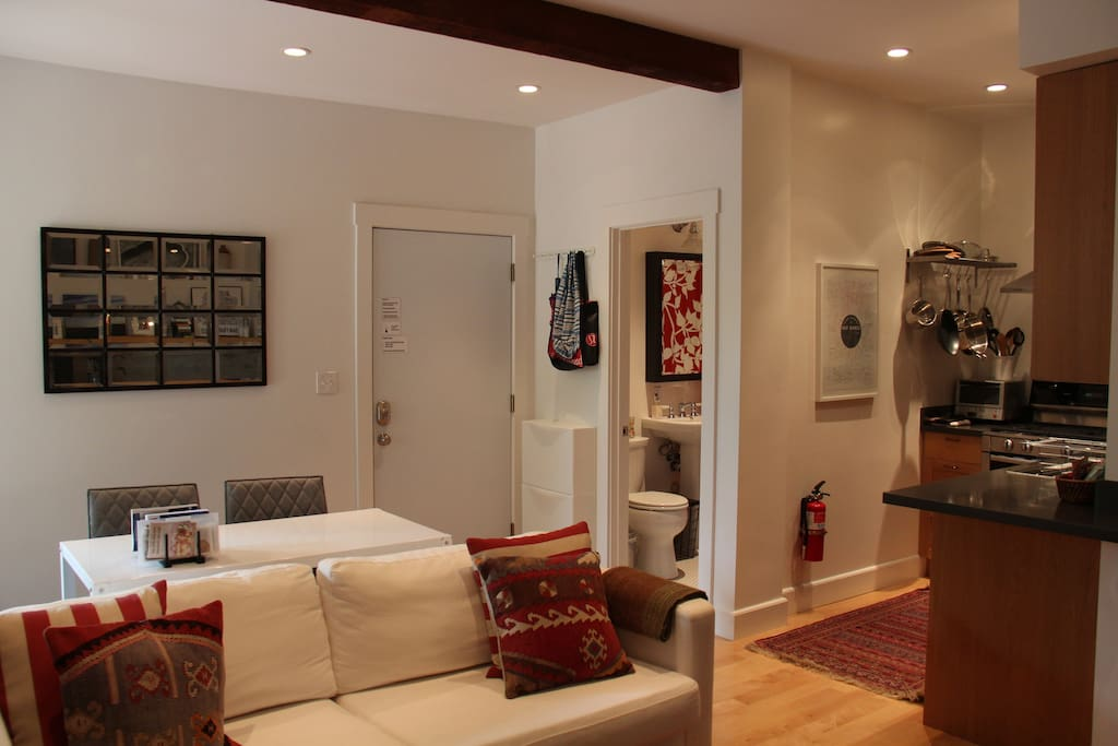 Open floor plan with wood floors and wool rugs throughout. High ceilings add to the bright & modern feel.