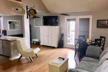 View from the front door, wood wall to the right!  The space with the mirror is now home to a queen bed!