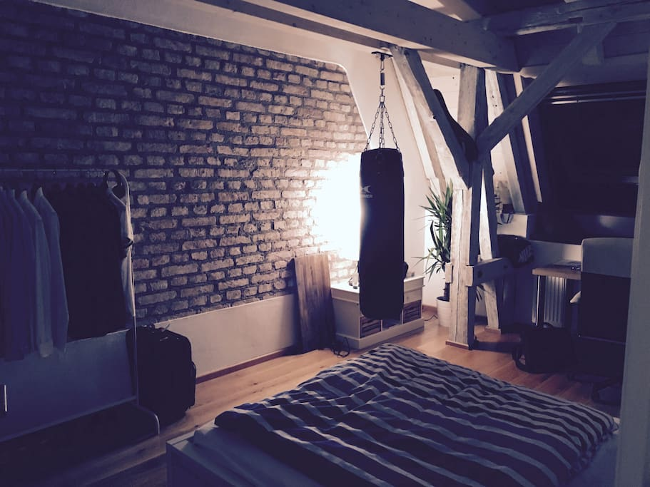 Your private room - chilled with a stylish stone wall and punching bag