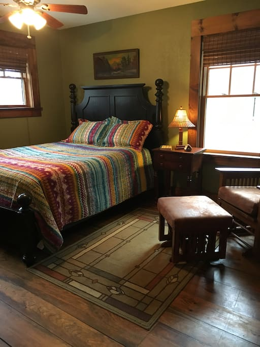 Extremely comfortable queen bed in a spacious bedroom with hardwood floors. Feels like being in a treehouse!