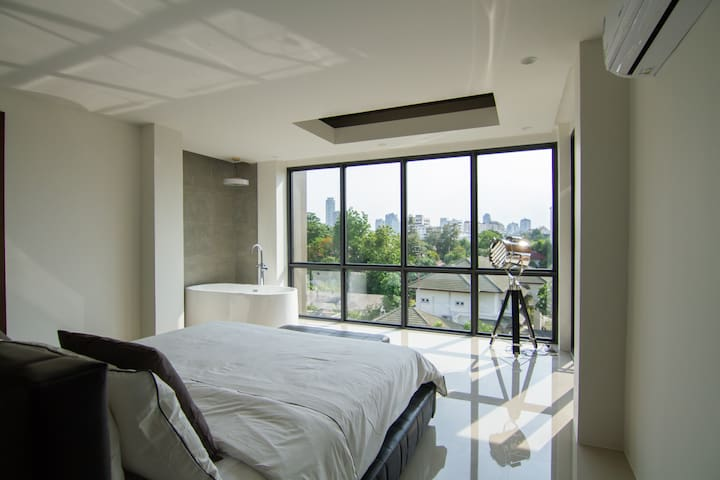 Master bedroom with open style bathroom
