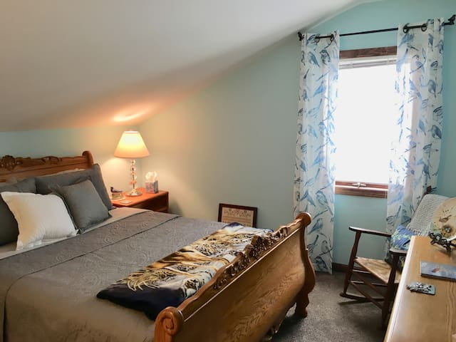 Master bedroom with queen bed. You can see the lake from both bedrooms. Plenty of storage space in the closet and dresser.