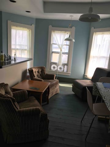 Yes, that is a window fan! This apartment features 2 air conditioned bedrooms. The lounge is not air conditioned.