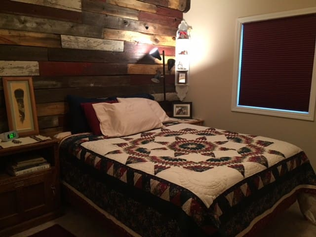 Small bedroom, horse theme, with queen size bed.