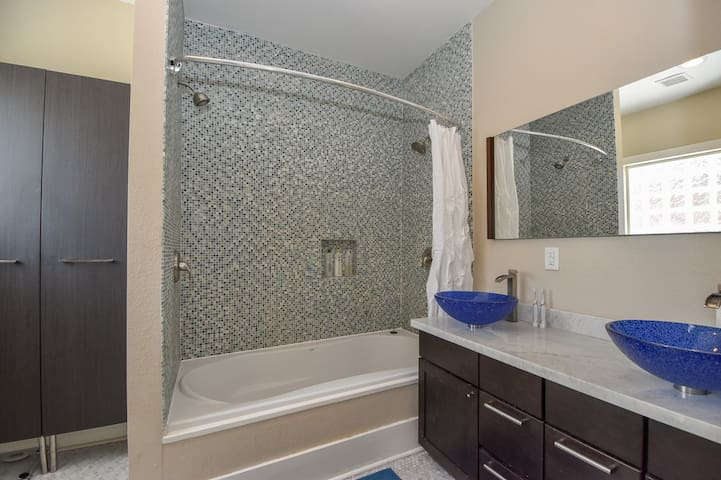 Dual showerheads and an extra-large soaking tub make for a romantic evening or efficient bedtime rituals!