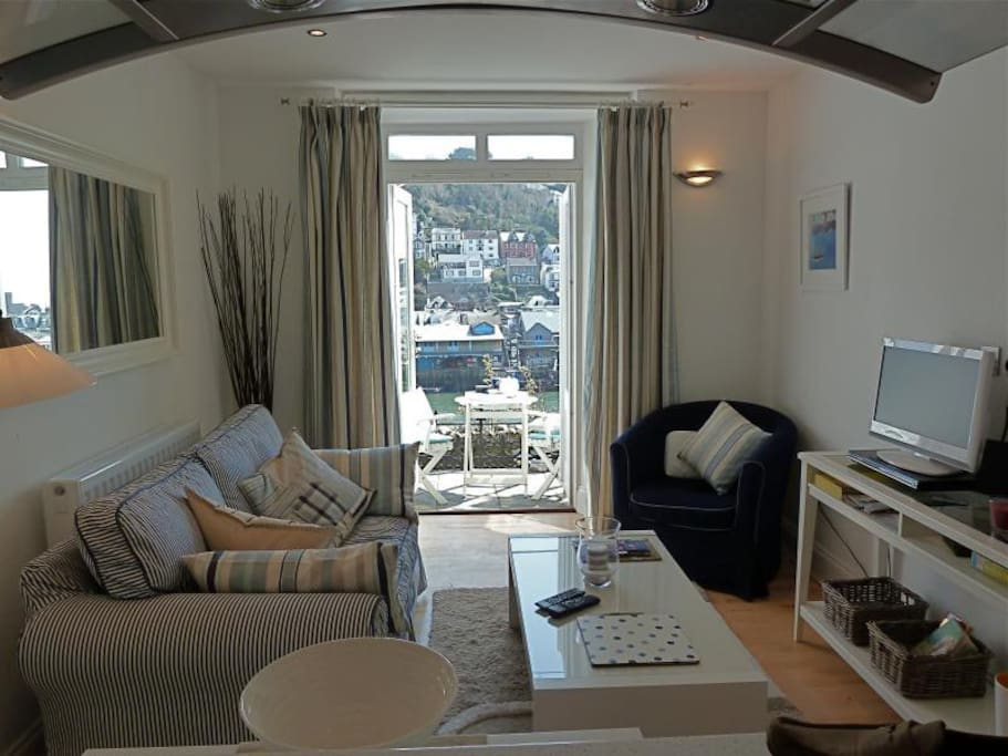 Lounge looking out through patio doors over looe harbour